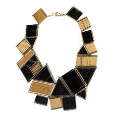 Google Image Result for http://whatshaute.com/wp-content/uploads/2011/04/Noir-Jewelry-Deco-Cubism-Shapes-Bugle-Bead-Necklace.jpg
