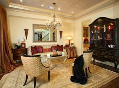 SUZANNE MYERS ELITE INTERIOR DESIGN: A sophisticated living room with a gold, glass bead ceiling from Donghia for an unexpected accent. A black Japaned bibliotheque with red-lacquered interior and recessed lights to display a wonderful porcelain collection.