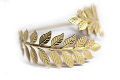 This lovely Greek style arm band has two impressive leaves soldered one on each side of the bracelet. The material is 24 karat gold plated brass. The Olive Leaf symbolizes beauty, peace and prosperity