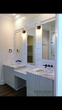 Love the faucets, colors, mirrors, all of it.