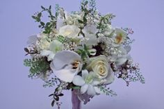 Ivory rose and orchid bouquet
