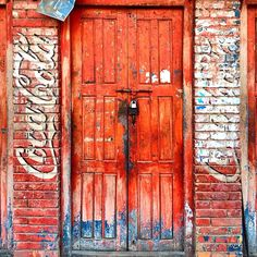 """doorway to the real thing : a 1927 coca-cola marketing slogan was """"around the corner from anywhere"""" : today it's almost true : it's marketed in every nation except cuba, sudan, iran, myanmar and north korea -/ #ktrap_doors series"""
