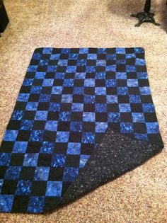 Blue and black quilt.