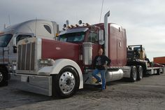 Lady trucker, Alison Morris shows her trucking pride next to her Peterbilit semi at the 2nd Annual Truck Driver Social Media Convention.    http://www.flickr.com/photos/truckingsocialmedia/