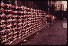 Freight handlers moving a stack of women's pasties outside a warhouse on Reade St.  32 Photos Of New York City In 1973