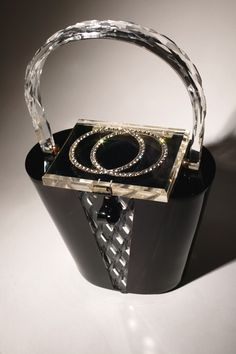 Vintage 1950's Black and White Lucite Handbag from the collection of Memphis native Caryn Schedit.