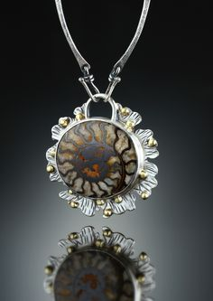 Fossil Ammonite Centerpiece. Fabricated Sterling Silver and 18k. www.amybuettner.com https://www.facebook.com/pages/Metalsmiths-Amy-Buettner-Tucker-Glasow/101876779907812?ref=hl https://www.etsy.com/people/amybuettner