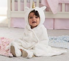 Nursery Fur Unicorn Bath Wrap. A cuddly, post-bath treat, this faux fur bath wrap adds supreme comfort and enchanting character to your baby's bath time. Pottery Barn Kids.