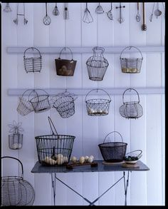 These are vintage wire collecting baskets used for transporting eggs and vegetables.
