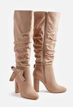 faf1dcb9003 Relish in the lush fall trends with these faux suede knee-high boots  featuring a slouchy shaft