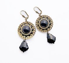 Awesome button earrings, a one of a kind statement design, in black and gold tones, with Victorian and Gypsy/Boho flavor. The beautiful, dimensional, timeworn buttons are perfectly complimented with exquisite Swarovski crystal pendants. These are bold but lightweight. The earrings hang on pretty brass leverback earwires.