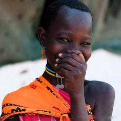 Africa    Lovely smile.  Place and Photographer ?