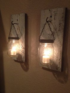 We love these mason jar candle holders. Mount them on wood panelling as a rustic alternative to wall lights. www.jossandmain.co.uk