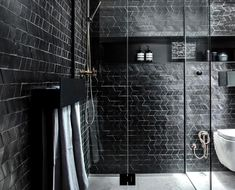 A moody bathroom with black tiles Black Tile Bathrooms, Bathroom Tile Designs, Chevron Tile, Black Chevron, Brunswick House, Modern Floral Arrangements, Unique Mirrors, Black Tiles, Mansions For Sale