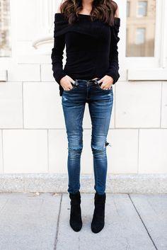 Distressed denim and black booties