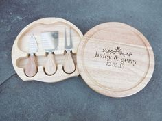 First Name & Date Round Cheese Board, Swivels Open w/ Cheese Tools, Custom Cutting Board, Personalized Cutting Board, Wedding cutting board by OurBoardBoutique on Etsy https://www.etsy.com/listing/263157745/first-name-date-round-cheese-board