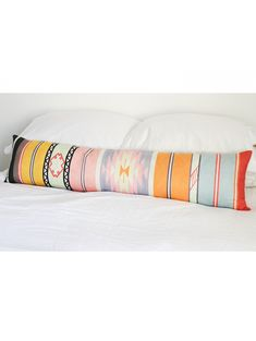 Designer Tip: You don't need tons of different throw pillows on your bed to make it stylish. If you are looking for something dramatic without the fuss, an extra long bed pillow is the perfect solution. We love this brightly colored tribal pillow for a fun touch to your space. Perfect for a laid back, bedroom that needs a pop of color. #landgwishlist