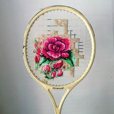 Cape Town based artist Danielle Clough (@fiance_knowles) embroiders colorful flowers onto retired wooden tennis rackets. See more of her work on HiFructose.com. #art #embroidery #sewing #craft