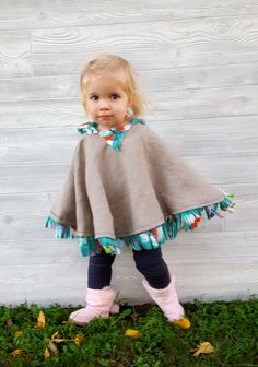 This cozy poncho is perfect as a jacket or winter coat for toddlers or little girls, and is fairly easy to make with this tutorial! {Reality Daydream}
