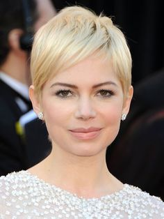 Michelle Williams ~A blend of short layers at the crown add definition to the actress's super-short feminine pixie cut.