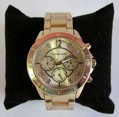 6821b0e38ea Relógio Michael Kors dourado c  brilho - Jackman