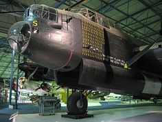 """Front of Avro Lancaster """"S for Sugar"""" of Squadron RAAF, on display at the RAF Museum in Hendon. Visible below the cockpit are the words """"No enemy plane will fly over the Reich territory"""" - a quote from the leader of the Luftwaffe, Hermann Göring. Air Force Aircraft, Ww2 Aircraft, Military Aircraft, Lancaster Bomber, Nose Art, Royal Air Force, Luftwaffe, World War Two, Wwii"""