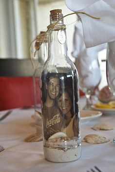 A message-in-a-bottle-inspired table number.Photo Credit: In His Image Film