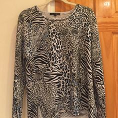 🎀Zebra & Blue Print Blouse ❌Zebra Animal Print Blouse by Pierri Size Medium is very colorful and comfortable. It has some black beading around the collar which enhances it's look. There is also a small slit on each side towards the bottom. Condition is Like-New. Pierri Tops Blouses