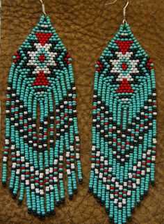 Long Beaded Fringe Earrings Native American by hoofandarrowYou can find Native american beading and more on our website.Long Beaded Fringe Earrings Native American by hoofandarrow Bead Jewellery, Seed Bead Jewelry, Seed Bead Earrings, Fringe Earrings, Seed Beads, Beaded Earrings Patterns, Seed Bead Patterns, Beading Patterns, Indian Beadwork