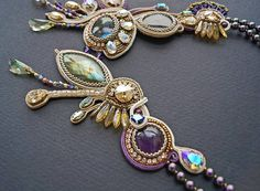 A new variation of the sexy flowing asymmetrical necklace in mixed technique that combines bead embroidery and weaving and soutache technique There are cabochons of amethyst, Labradorite, Swarovski crystals and crystal pearls at this shining design. I really love the feminine soft flowing flexible necklace, they adorn the chest, at the same time, not burden it. This type of necklace suits well with diverse outfits and especially is ideal for women from L size. Extension available