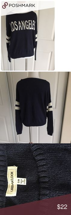 Los Angeles sweater in navy w/striped sleeves S/M ♦️Excellent condition. No holes, stains. Minor piling.                                                 ♦️Materials- 100% acrylic                           ♦️Measurements:                                                ♦️Laying flat armpit to armpit: approximately 20 inches                       ♦️Laying flat from the back of the neck to the bottom of the front hem is approximately 22 inches Boutique Sweaters Crew & Scoop Necks