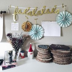 Festive holiday decor with colorful pin wheels and chalkboard wood slices