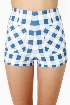 Ozzie Gingham Zip Shorts: Super cute blue and white gingham shorts featuring a high waist and front pockets. Exposed zip closure at back, stretch fabric. Fully lined. Looks perfect with a bandeau top and bright red lips! By Nasty Gal.