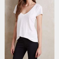 FLASH⚡️NWT Anthropologie White V Neck/Back Tee NWT Anthropologie white tee. Has v neck and adorable v back design. Very cute detailing. And little slits in the sides. Perfect basic tee. True to size. Easy to layer or wear with any denim. A summer staple! 50% cotton 50% modal. Anthropologie Tops Tees - Short Sleeve