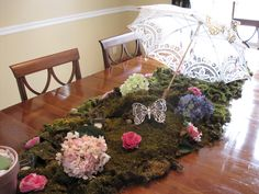 So we did a bridal shower..used a battenburg lace parasol, added crystals, butterflies. On the table we covered it with plasitc and moss add in flowers and for a perfect garden tablescape.
