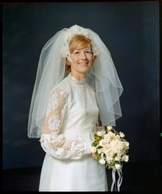 Bride, Lyndsay Shaw (nee Neal) stands in a three-quarter pose. She wears her wedding dress, veil and holds a bouquet. On 1 July 1972, she married Robert Shaw. Robert Shaw, Vintage Weddings, Veil, Bouquet, Poses, Bride, Wedding Dresses, How To Wear, Image