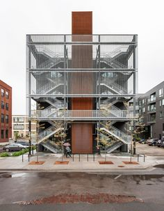 A prominent pair of fire evacuation staircases run up one of the exterior walls of this building, linking up with a set of balconies. The architects envisioned these as more than a purely functional feature.
