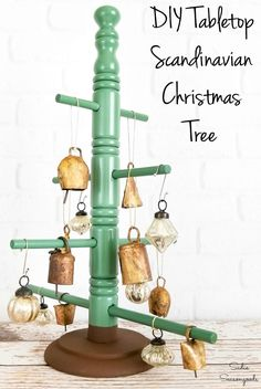 A coffee cup tree from the thrift store is PERFECT for upcycling into a Nordic Christmas tree for a minimalist look. Scandinavian Christmas decorations are so trendy, and you can jump on board with this easy upcycling idea! #diychristmas #diychristmasdecorations #scandinavianchristmas #nordicstyle #nordicchristmas #scandinaviandecor #xmastreedecorations #xmastree #christmasdecorationideas #christmascraftideas #christmascraftsdiy