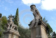 Photo made in Monselice ancient medieval village that is located in the park of the hills Hills in Veneto (Italy). In the picture above you see two columns with a square base, placed on either side of the street that leads to the seven churches, two statues of two great lions with a crown on his head silhouetted against the blue sky.