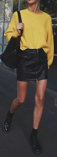 #winter #outfits yellow sweater and black leather miniskit. Pic by @newyork_streetstyles.