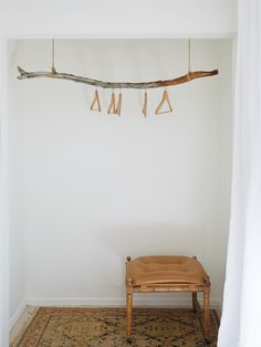 A particularly artful use: branch as clothes rack in The Joshua Tree Casita: A Stylish DIY Remodel, Budget Edition.