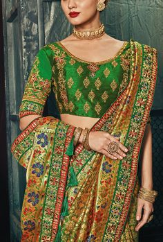 Featuring green designer embroidered party wear saree. TOP: Banarsi Silk FABRIC: Banarsi silk COLOR: Green - The product will be shipped within 1 to 2 weeks from the date of purchase. - Product is returnable if un-Stitched - This product qualifies for free shipping