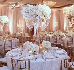 Love these tall bouquets and the ambiance of the room. Perfect for dinner.