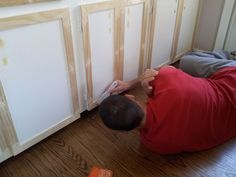 turn plain cabinets into shaker. I would paint the boards before installing, then touch up.