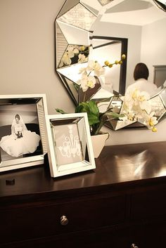 Adore the mirror. Would love to paint the dresser fuchsia & rough it up a little bit.