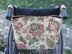 This reversible floral wheelchair bag is made out of a 100% cotton upholstery fabric for extra durability.  Colors in the floral pattern include