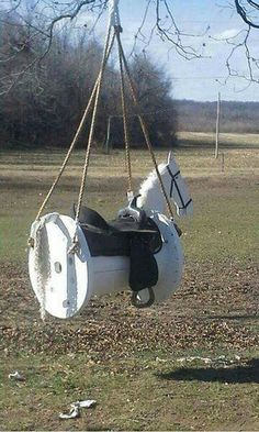 Turn a CABLE SPOOL into this awesome HORSE SWING...what a great idea for the Kids! What do you think? #outdoors #survival http://www.reelfishingadventures.com