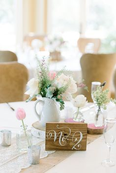 Painted wooden table number #decor Photography: Michelle Lange - loveandbemarried.com  Read More: http://www.stylemepretty.com/2014/08/14/romantic-pastel-military-wedding/