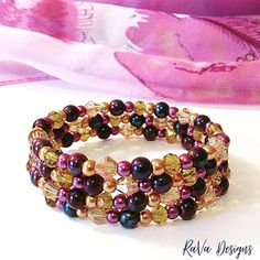 handmade stacked bracelet gold and purple plum beads layered pattern ideas memory wire jewelry Memory Wire Jewelry, Wooden Jewelry, Beaded Jewelry, Polymer Clay Magnet, Clay Magnets, Diy Bracelet Storage, Happy Birthday Chalkboard, Pumpkin Leaves, Jewelry Rack