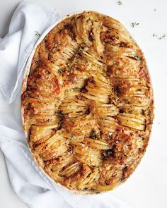 Potato Kugel Gratin - Martha Stewart Recipes (sub veggie broth & would need to find Matzo meal) *